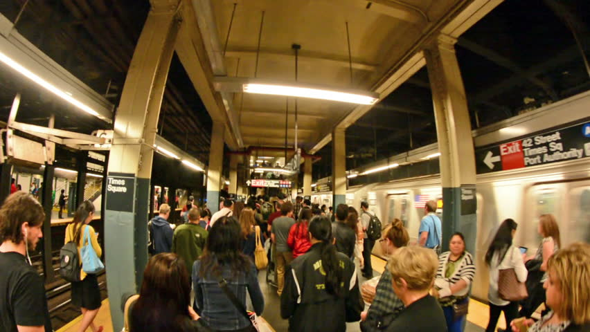NEW YORK CITY - JUN 9: Commuters exit subway station on June 9, 2013 in NYC. The NYC Subway is one of the oldest and most extensive public transportation systems in the world, with 468 stations.