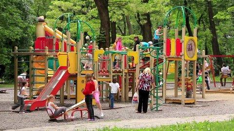 KIEV, UKRAINE, MAY 9, 2010: Boys and girls at new childrens playground, Kiev, Ukraine, May 9, 2010