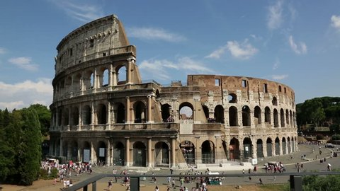 Colosseum, Rome, Italy. Roman Coliseum on summer day with blue sky. Beautiful view of the famous Italian landmark travel icon in the Roman forum.