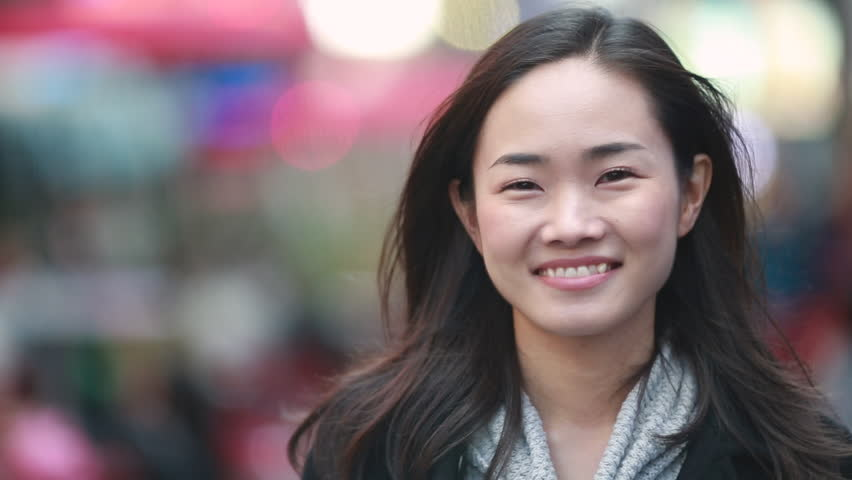 Asian woman in New York City Times Square street smile happy face
