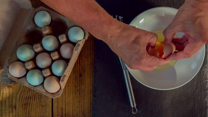 Cracking Farm Fresh Organic Eggs