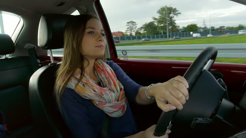 self confident brunette taking a right turn in a car