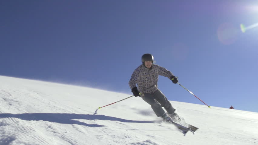 Slow Motion Of Skier Skiing Down The Snowy Slope On A Sunny Winter Day.