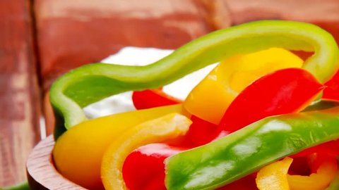 peppers sliced for salad on wooden table 1920x1080 intro motion slow hidef hd
