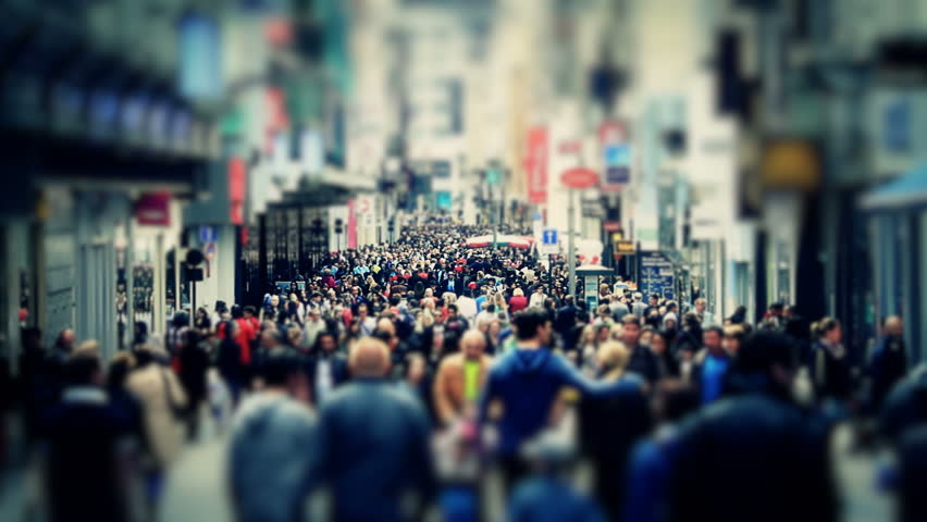 City pedestrian traffic shot on a busy Brussels shopping street using a tilt shift effect and added color correction.
