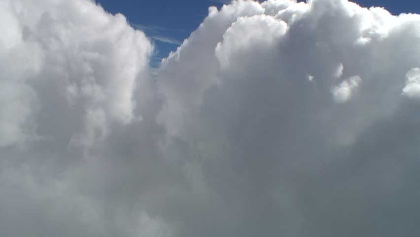 Flying into the crack between two large cumulus clouds. Organic cloudscapes.