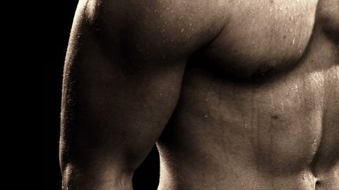 Extreme close up of mans bicep doing arm curls
