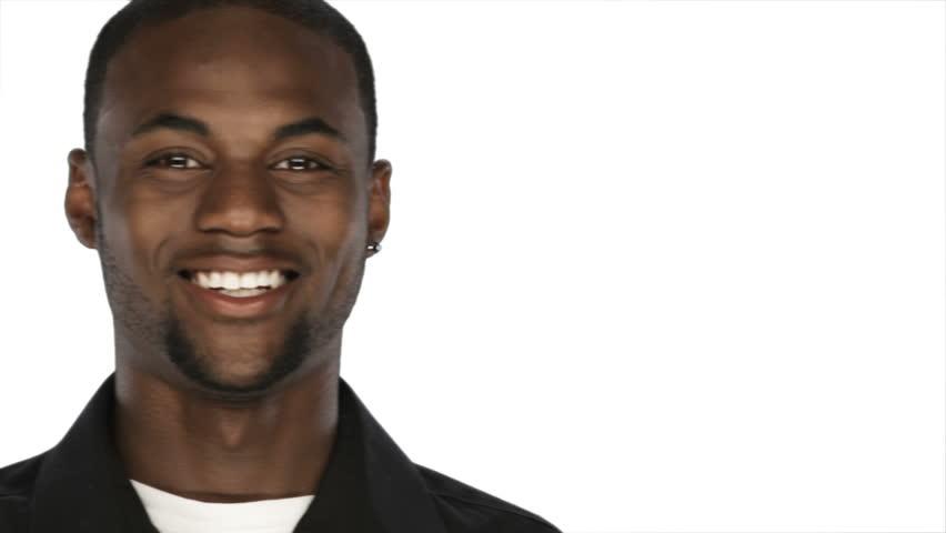 A Black Man On A White Background Smiles Stock Footage ...