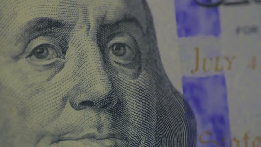 Security hologram on a new 100 dollar bill   Shutterstock HD Video #4996208