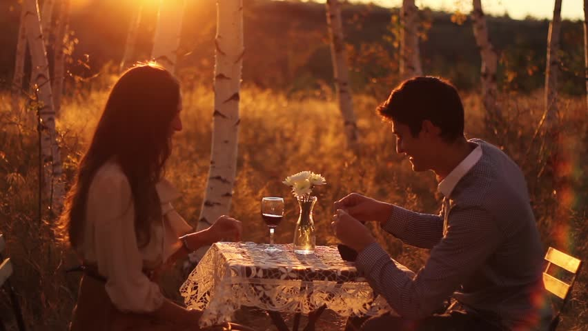 Young Couple Marriage Proposal at Sunset Romance Concept