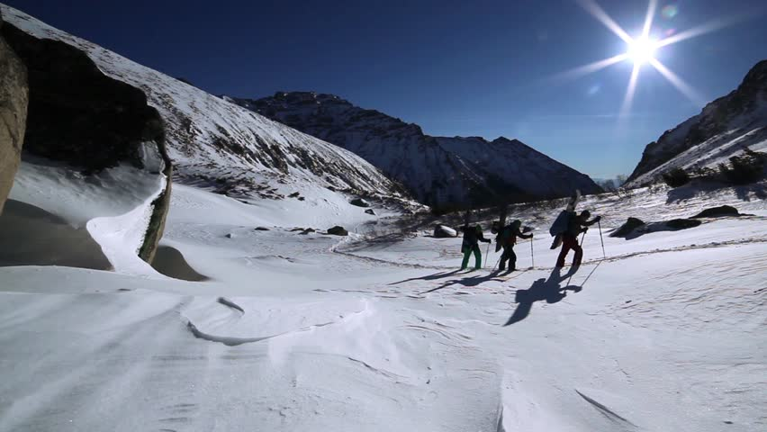 Snowboarders go up to mountain and carry snowboards | Shutterstock HD Video #5009420