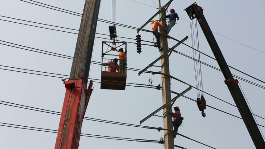 Saraya Oct 27:Electriciasn are installing hight powered electric cables to cope with the increasing power usage of cities surrounding Bangkok. in Saraya Nakhonpathom Thailand on Oct 27,2013