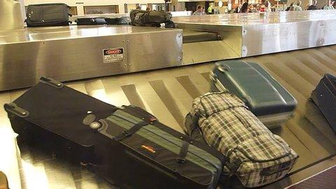 Interior Maui Hawaii Airport baggage claim with luggage spinning around conveyor.