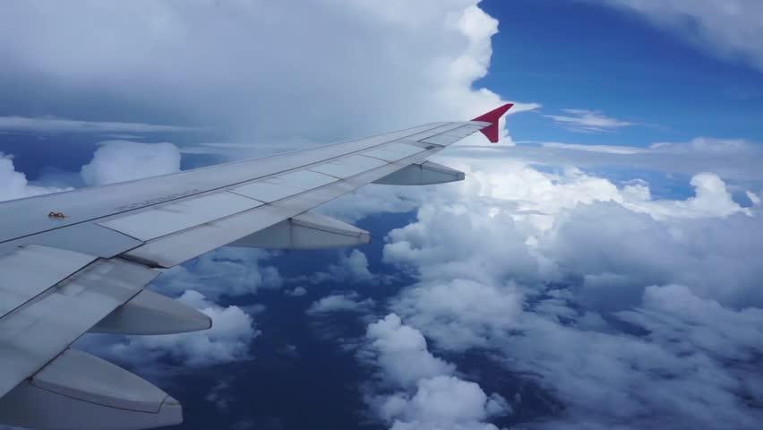 View through an airplane window blue sky