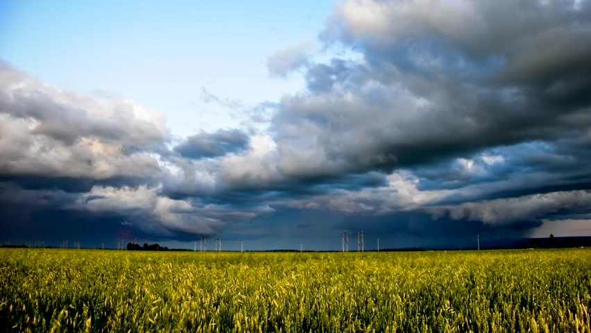 hd time-lapse colorful storm sky over grain field