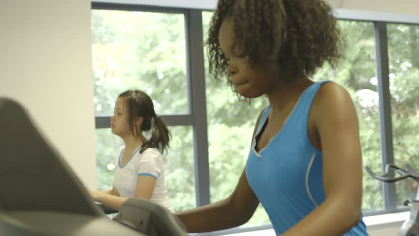 MS R/F Two girls doing exercise in gym