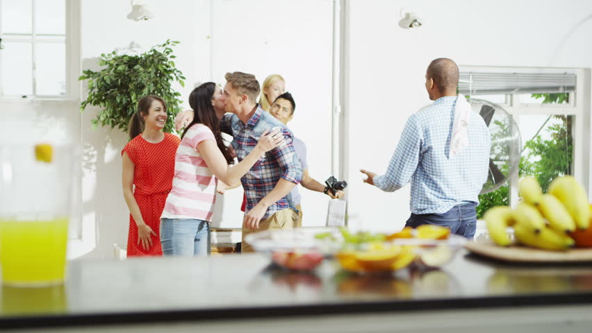 friendly couple hosting a party at home greet their guests as they arrive in slow motion stock footage video 5099348 shutterstock - Hosting A Party At Home