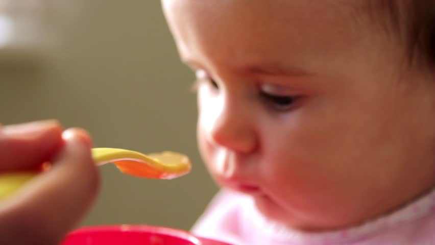 Feeding a small child  | Shutterstock HD Video #5101193