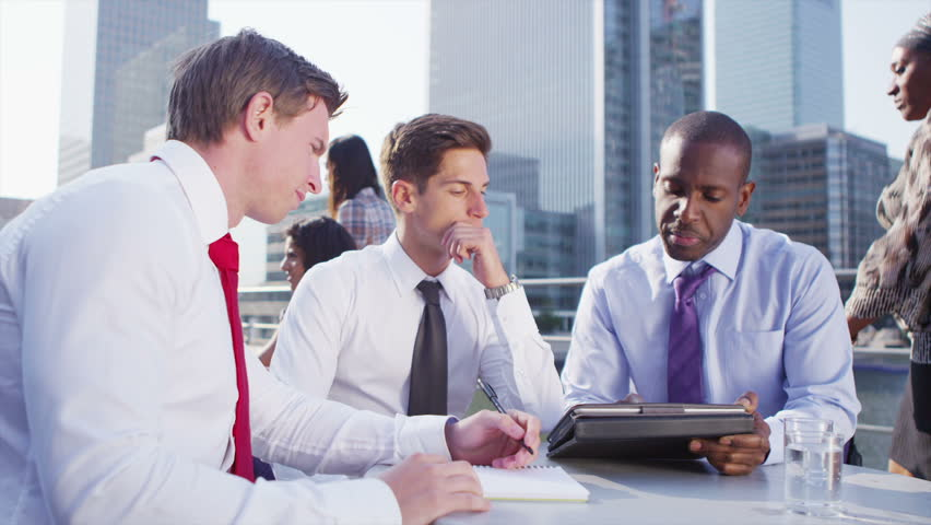 Cheerful and attractive mixed ethnicity group of business men having an informal meeting on office rooftop terrace on a sunny day. In slow motion. | Shutterstock HD Video #5110136