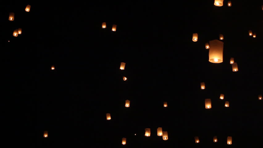 Floating lanterns in Yee Peng Festival, Loy Krathong celebration in Chiangmai, Thailand. Tele zoom angle view.
