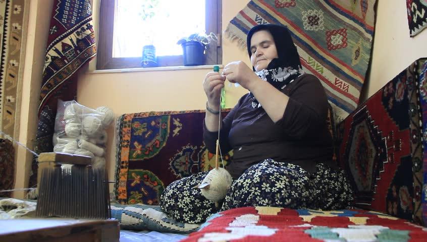 TURKEY, ANTALYA, JUNE 21: 2011: Carpet weaving. Aged turk woman with