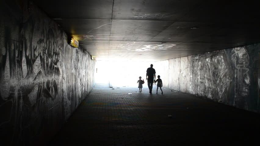 stock video of man with children girls walk through