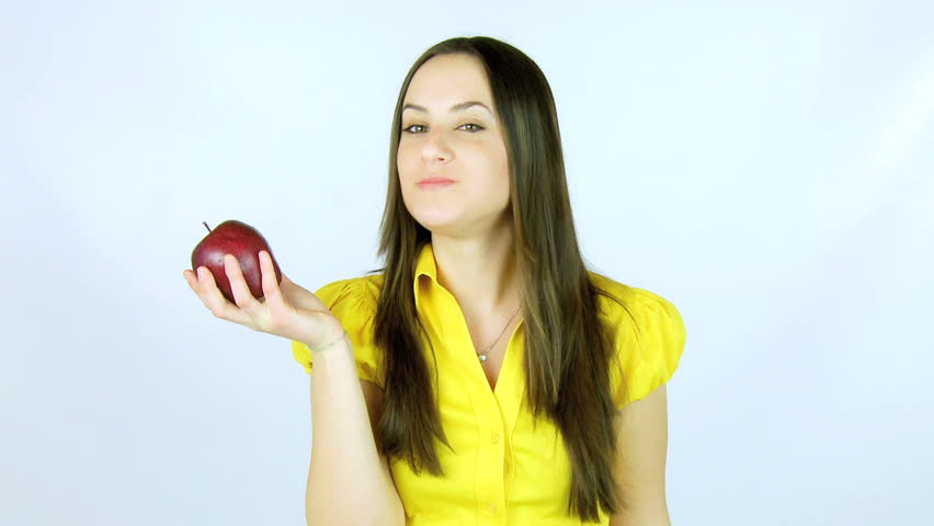 Woman ready to eat red apple happy