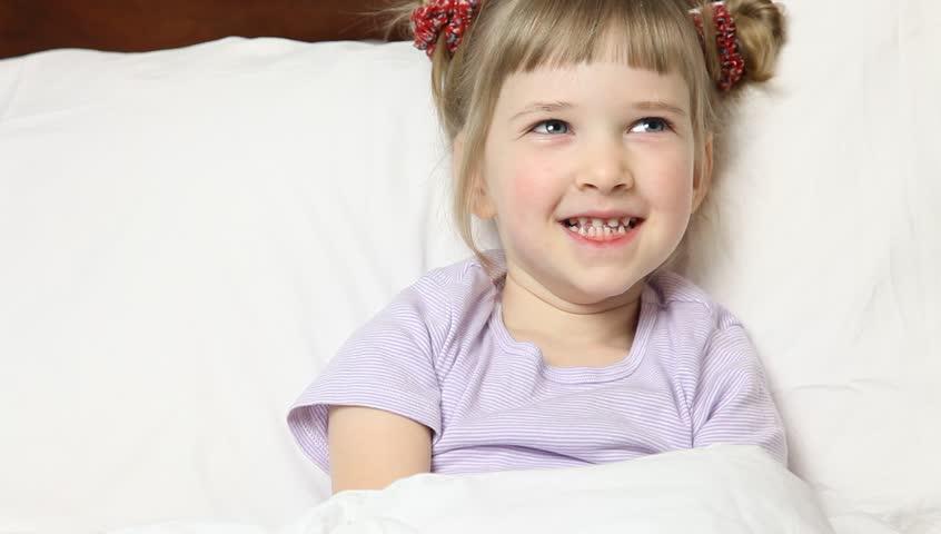 Little girl taking medicine in bed | Shutterstock HD Video #5185928