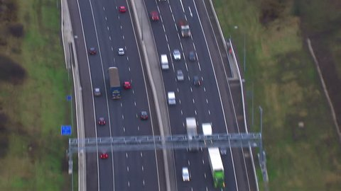 Aerial view of a traffic driving on a motorway through the English countryside.