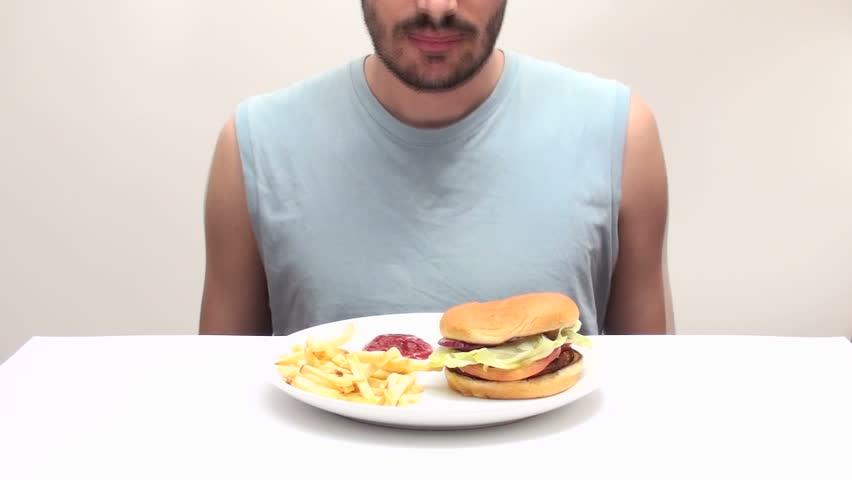 Man eats burger time-lapse
