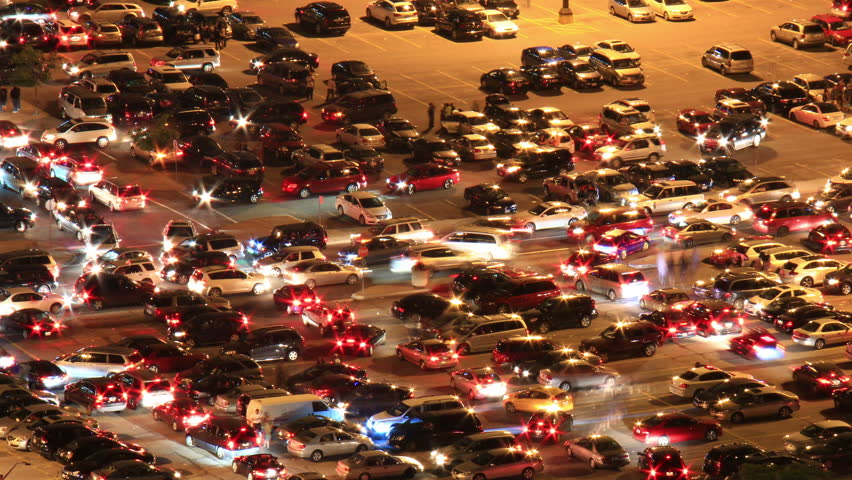 Parking Lot Night Timelapse. Time-lapse night shot of a crowded parking lot