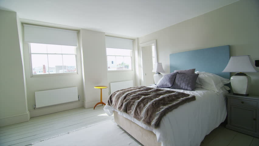 View of elegant bedroom in a stylish, classically designed home with a contemporary feel. No people.