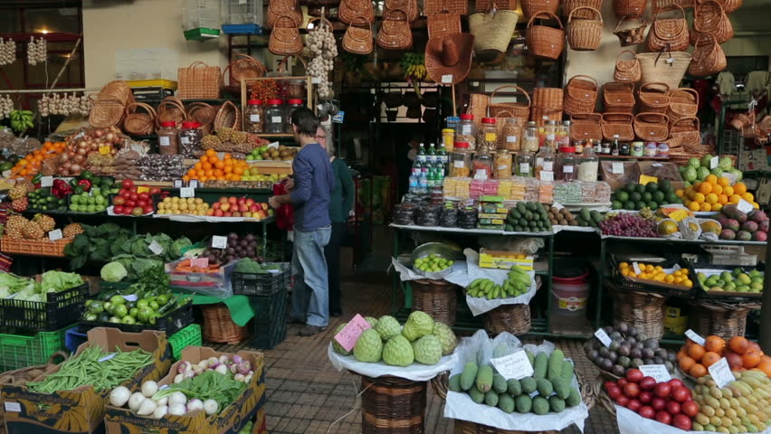 FUNCHAL, MADEIRA/PORTUGAL - NOVEMBER 14: Unidentified people buy fruit on November 14, 2013 in Funchal. The worker's market was built in 1940 to provide a central location to sell local produce.