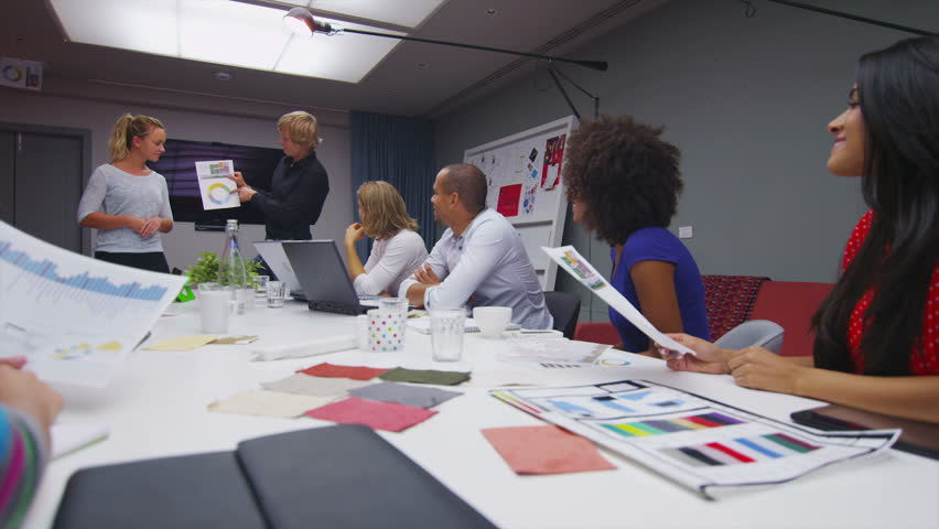 Creative casual business team in a boardroom meeting. In slow motion. | Shutterstock HD Video #5258618
