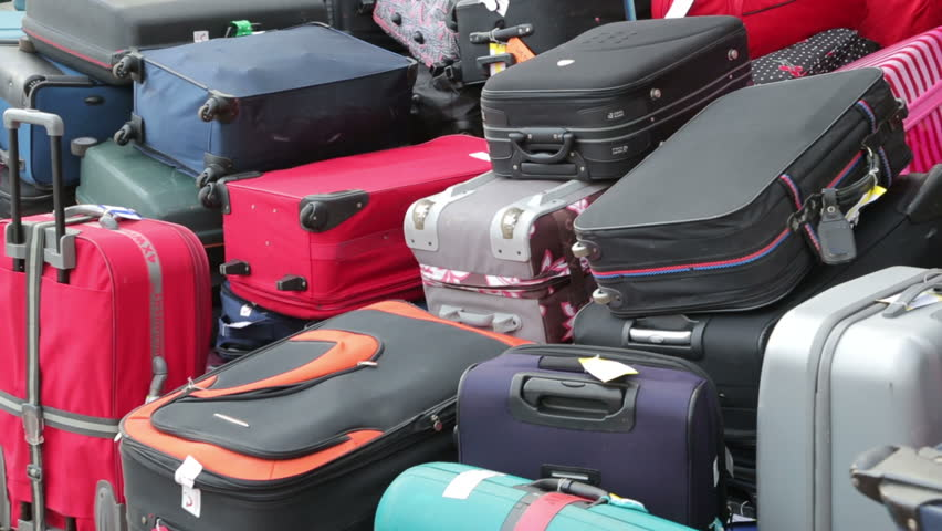 Pan of baggage on cruise ship waiting to be off loaded | Shutterstock HD Video #5277698
