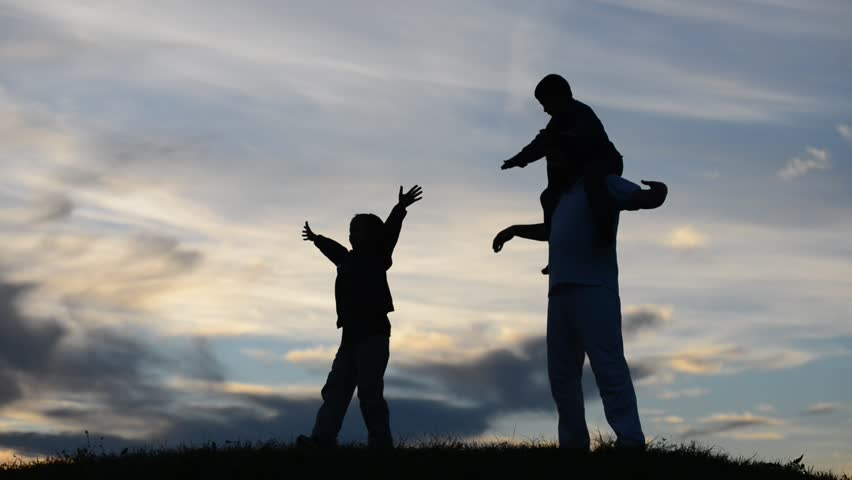 Young father playing with sons on meadow circling them and jumping running for fun | Shutterstock HD Video #5281670