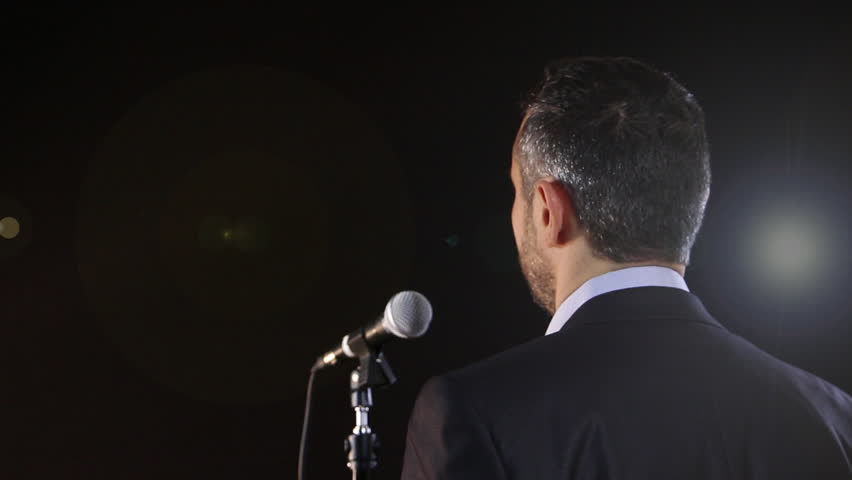 Rear view of a speaker speaking at the microphone | Shutterstock HD Video #5322029