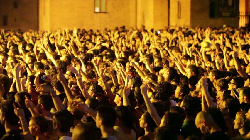 "Ferrara, Italy - June 12, 2013: Cheerful audience during the music Festival called ""Ferrara sotto le Stelle"". Concert of the rock group ""Fun"". #5325218"