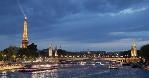PARIS, FRANCE - JULY 25, 2013 Iconic Eiffel Tower Paris, Tourists Visit in Tour Boats on Seine River Trip French Travel Illuminated Night ( Ultra High Definition, Ultra HD, UHD, 4K, 2160P, 4096x2160 )