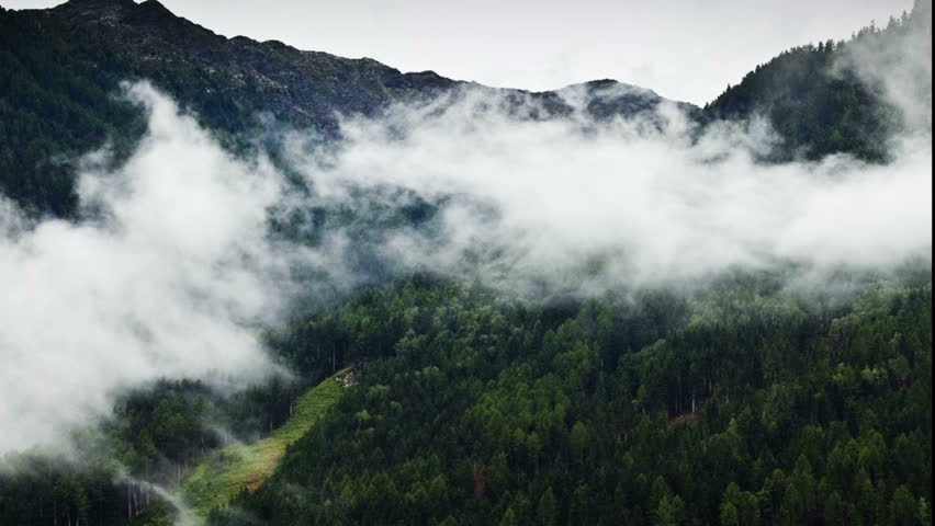 Time lapse of clouds in front of a mountain covered of a pine forest in Obervellach- Austria | Shutterstock HD Video #5329028