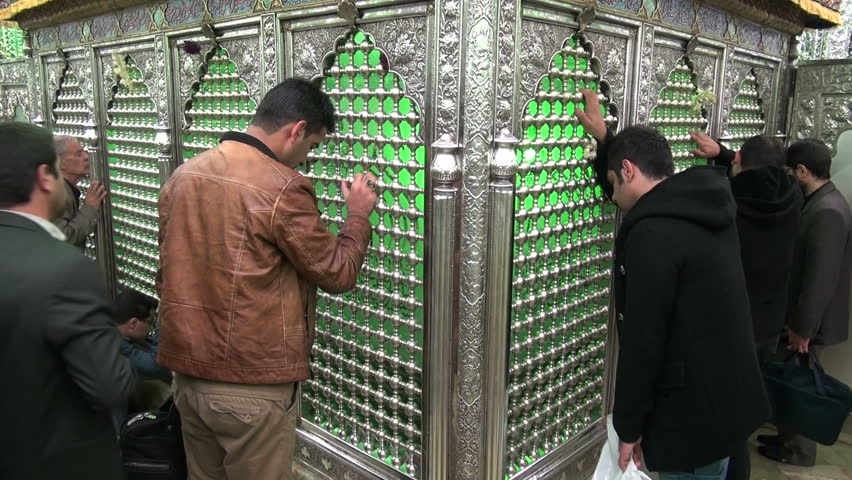 TEHRAN, IRAN - 11 NOVEMBER 2013: Men are mourning at a shrine, during the Muharram period, in Tehran, Iran