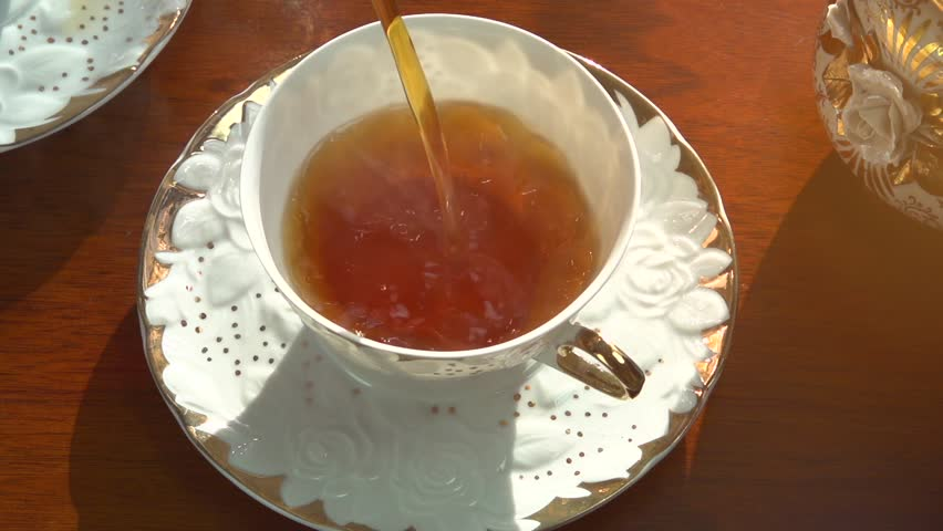 Tea Pouring. Porcelain cup of Healthy Tea closeup. Slow motion video footage 240fps | Shutterstock HD Video #5354048