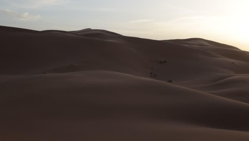 Desert dune during a windy day. Pan view. Erg Chebbi, Maroc. HD1080p Canon 5Dmk4 | Shutterstock HD Video #5356208