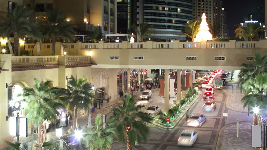 View on the walking street with palms in dubai city    Shutterstock HD Video #5366588