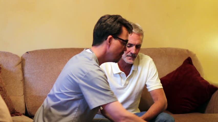 Healthcare worker visits elderly patient. Shot in Moreno Valley, California in November, 2012.   Shutterstock HD Video #5371067