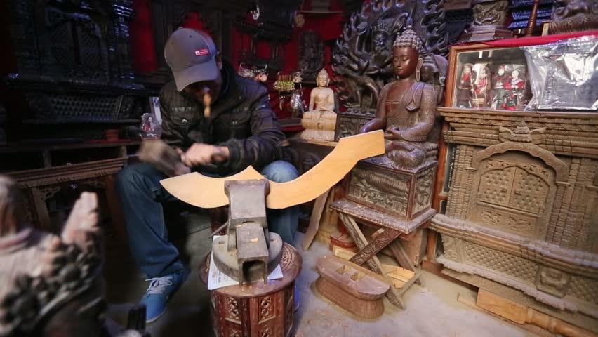 BHAKTAPUR, NEPAL - DEC 5: Unidentified Nepalese man working in the his wood workshop