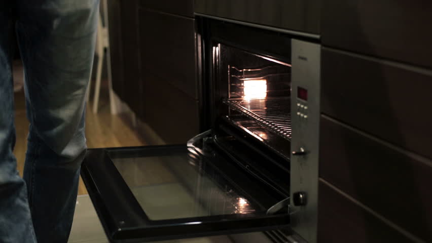 Man putting food in the oven