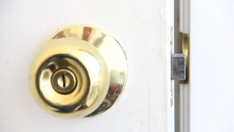 Golden Handle in white door closing