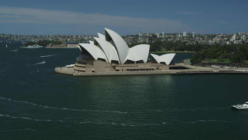 SYDNEY, AUSTRALIA - OCT 2009: The Opera House with Ferry Boats passing