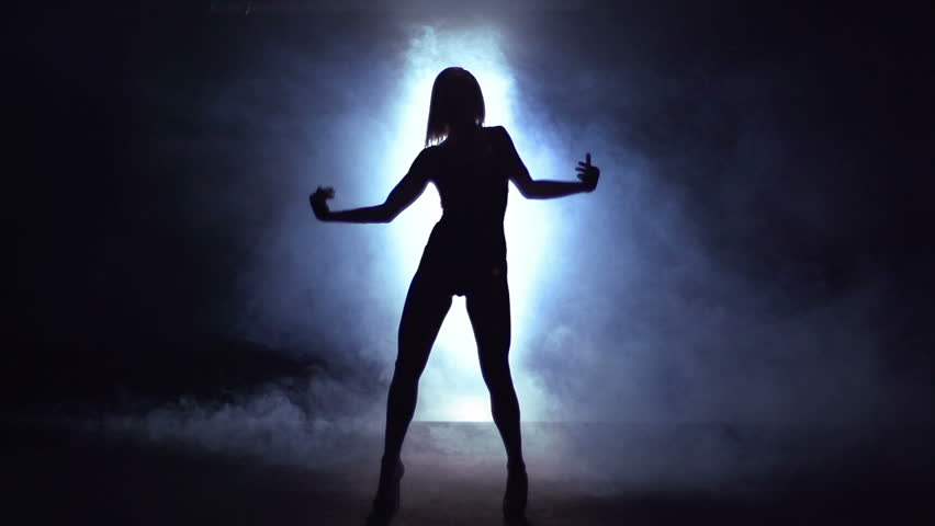 Sexy girl making the show on stage wrapped in smoke against the light | Shutterstock HD Video #5395568